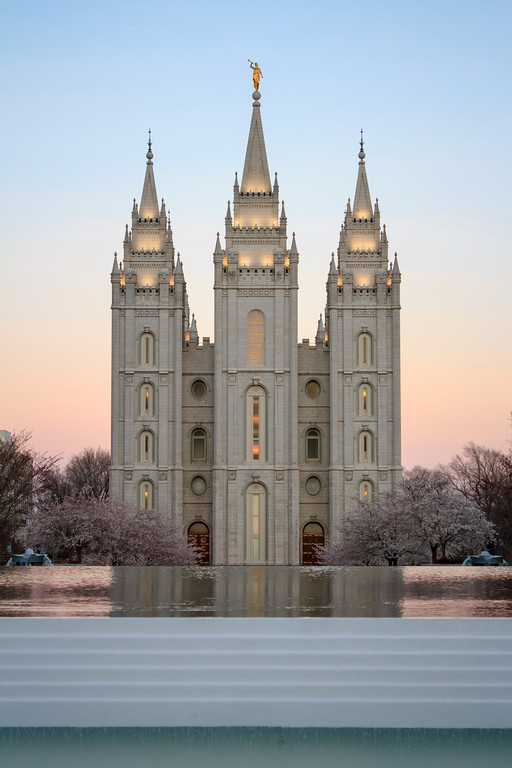 Salt Lake Temple at dawn behind fountain