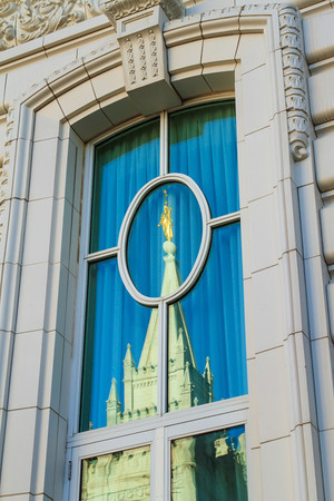 Salt Lake Temple reflected in window